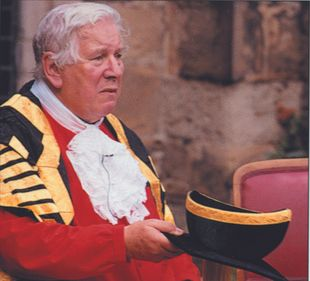 Sir Peter Ustinov in Chancellor academic dress