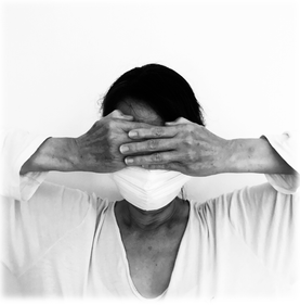 Woman in respirator mask covering her eyes
