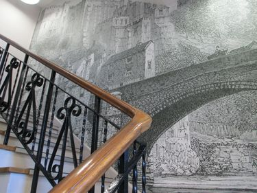 Wall mural behind a staircase in the Department of History