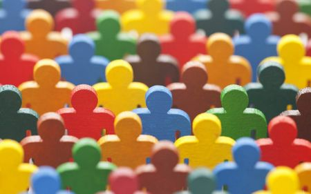 Group of colourful wooden people