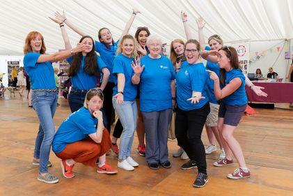 DUVO Volunteers smiling wearing blue T shirts