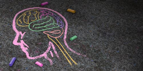 A chalk outline of a human head on a footpath