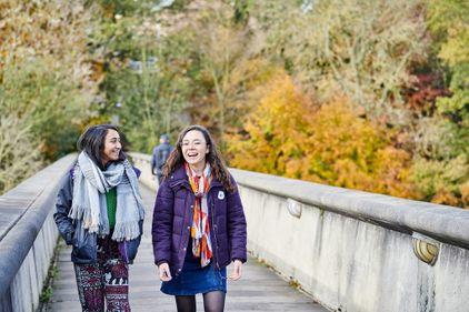 Students on Kingsgate bridge in autumn
