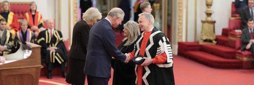 Receiving award at Buckingham Palace