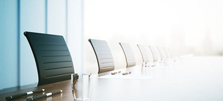 A row of empty chairs in a meeting room
