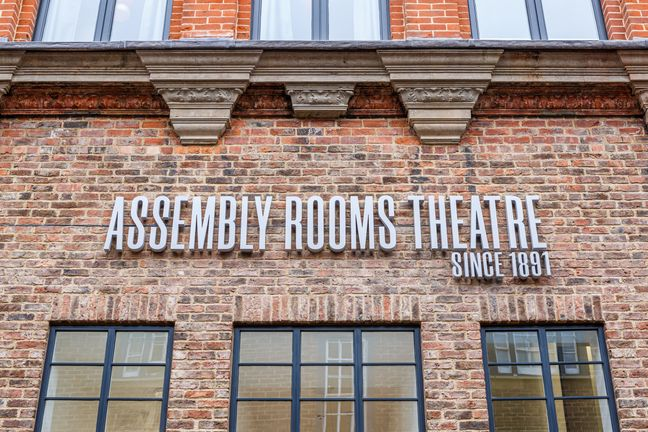 Sign outside the theatre saying Assembly Rooms Theatre since 1891