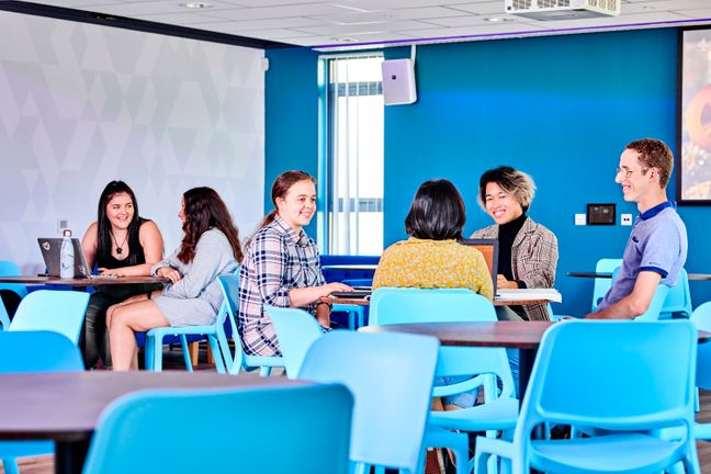 Students sitting in South College Social Space