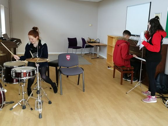 Group of students using the Music Room