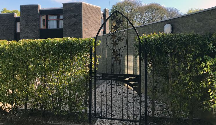 The gated entrance to the Garden of Reflection