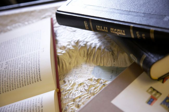 Close-up of books resting on 3D map