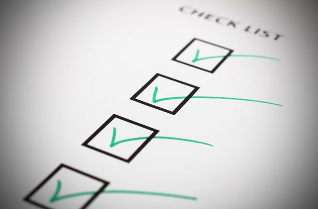 Tick boxes marked with a tick on a checklist
