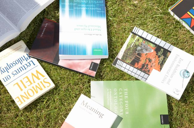 Philosophy books placed on grass