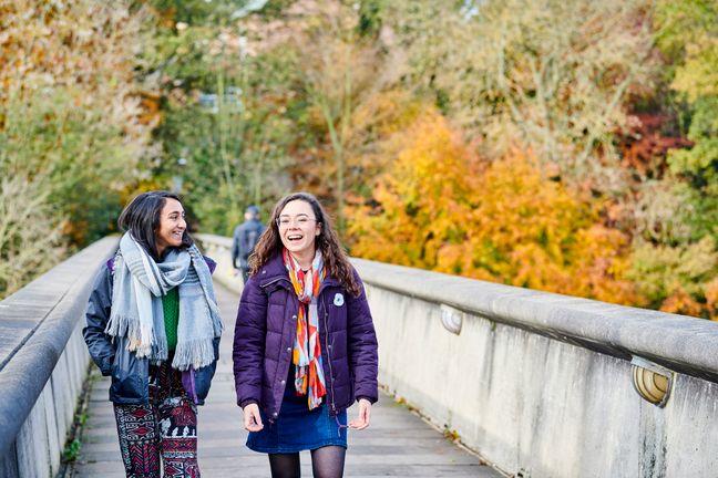 Two students talking on Kingsgate Bridge