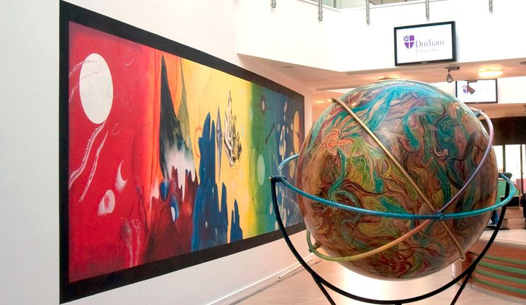 The Palatine Centre lobby with globe and artwork
