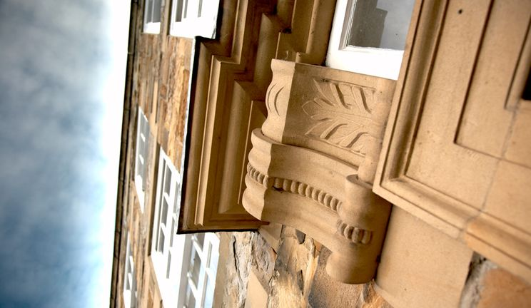 Ornate door mouldings around the entrance of Abbey House, Palace Green, Durham