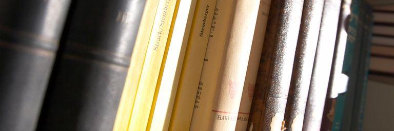 A selection of academic textbooks on a bookshelf