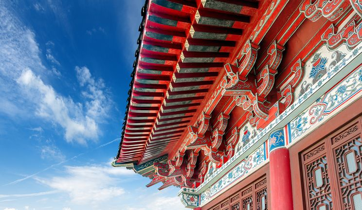 A Chinese Pavilion arch against a clear blue sky