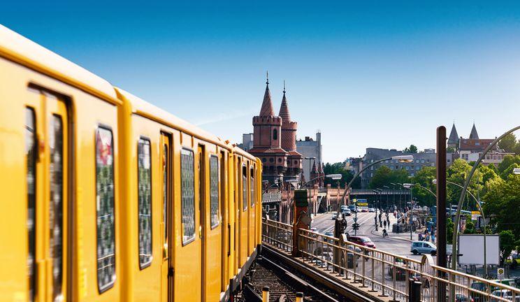 A tram in Berlin going over a bridge