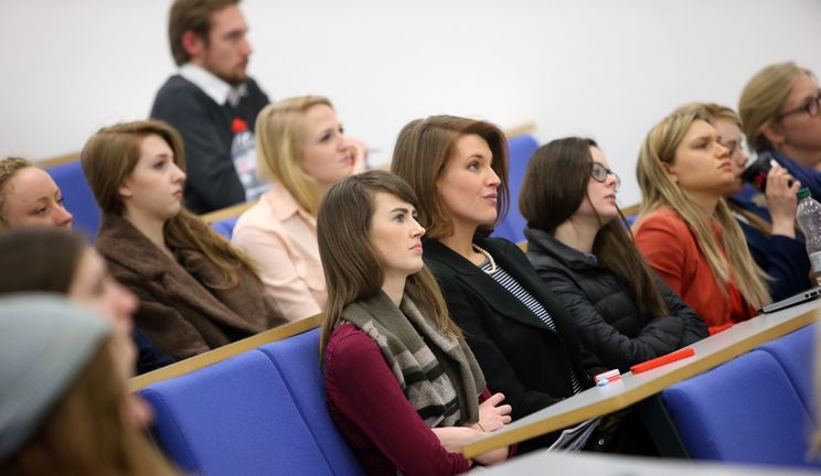 A large lecture theatre filled almost to capacity