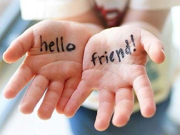 Hello Friend Written on Child's Hands