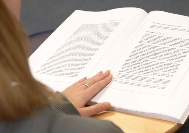 Person reading Human Sciences book