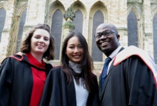 Group of smiling graduates outside Cathedral