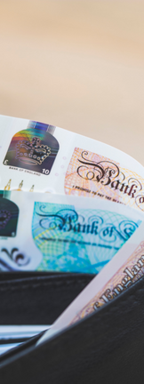 British pound notes inside a wallet