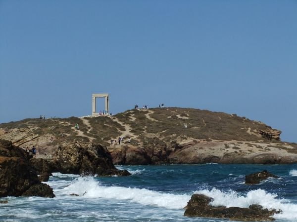 A photograph of the ancient ruins on a headland overlooking the sea