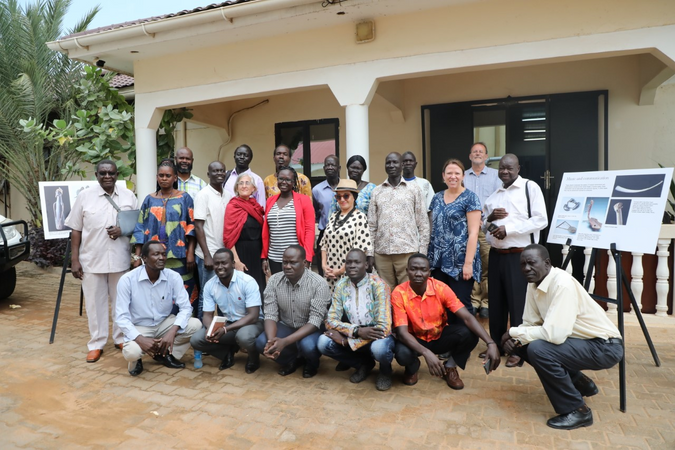 A photograph of a group of participants at a workshop in South Sudan,