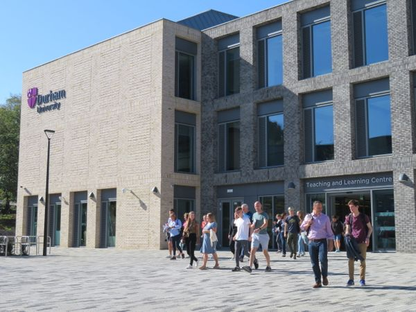 New students and parents walking out of the Teaching and Learning Centre