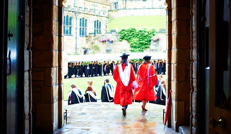 Graduating students lining up in the Castle courtyard