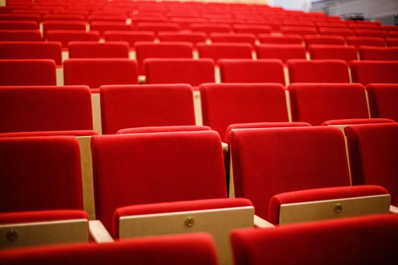 Rows of red seats in the Assembly Rooms Theatre Oct 2019
