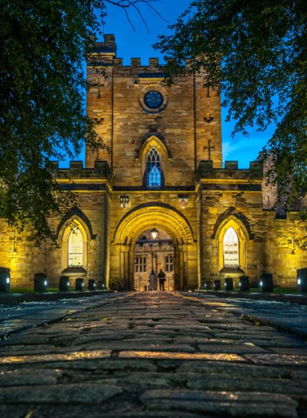 Exterior of Durham Castle lit up at night