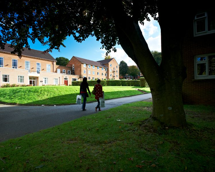 Two students walking outside Grey College