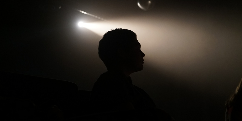 Silhouette of a student under a spotlight
