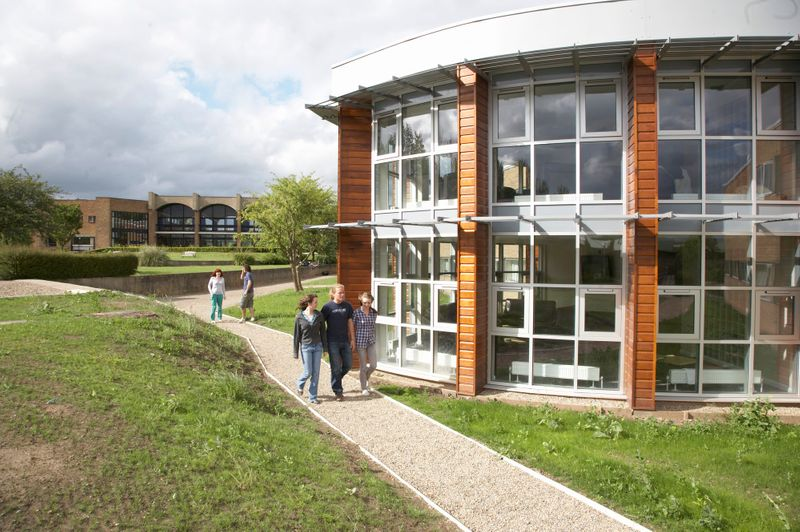 St Aidan's College exterior with people