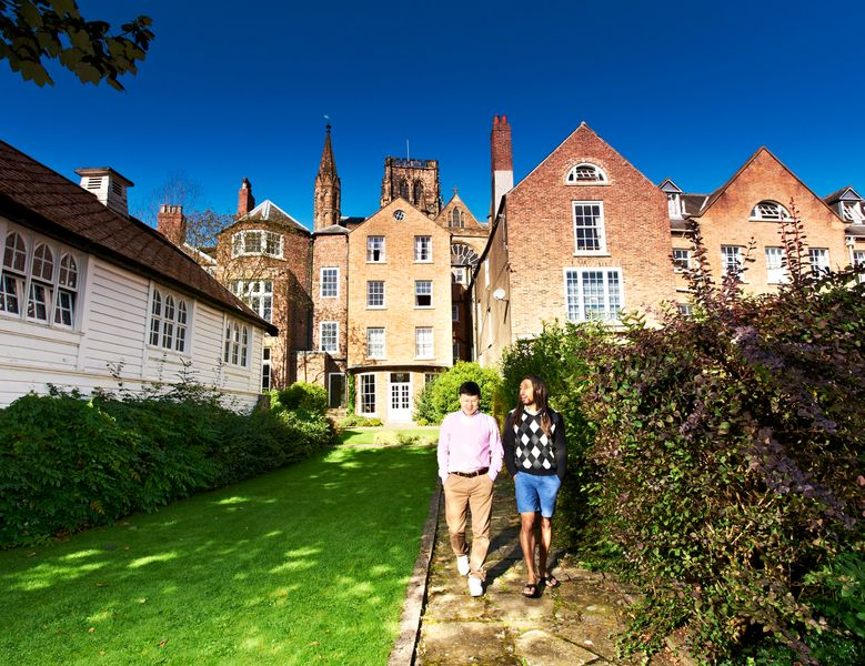 Postgraduate students walking outside St Chad's College