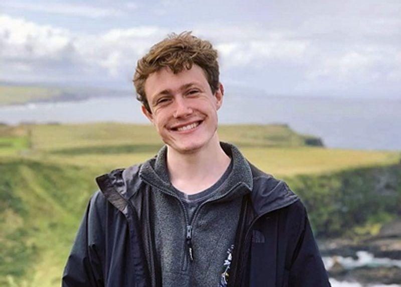 A student testimonial photograph of Ewan