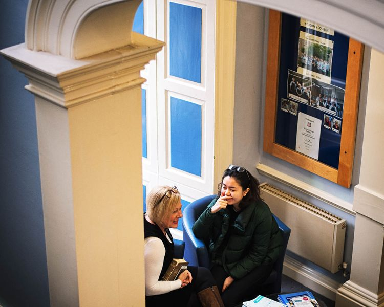 Staff member meeting with a student for a chat