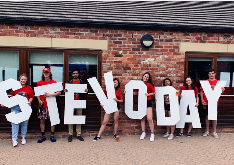 Group of students holding the letters Stevo Day in front of Stephenson College