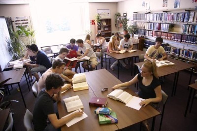 Students researching their chosen topics in the the library study space