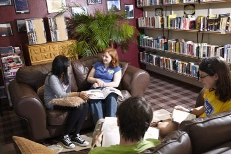 A group of postgraduate students relaxing in the Middle Common Room