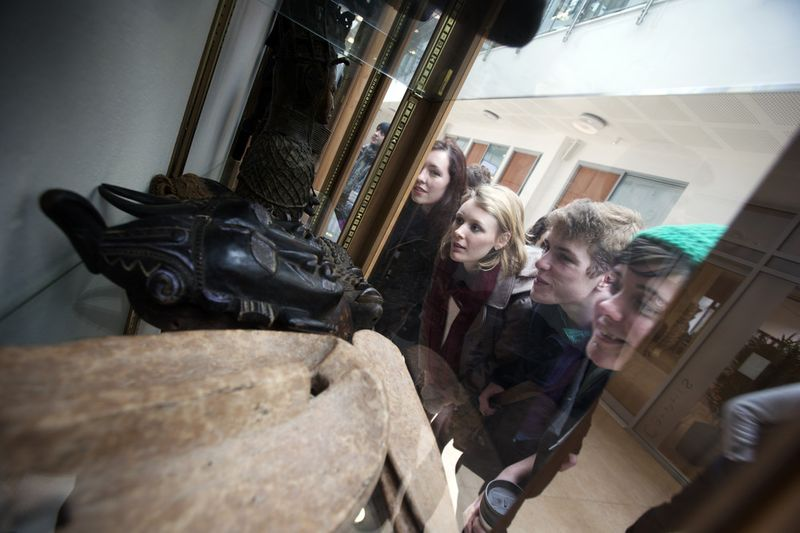 Students looking at a window display