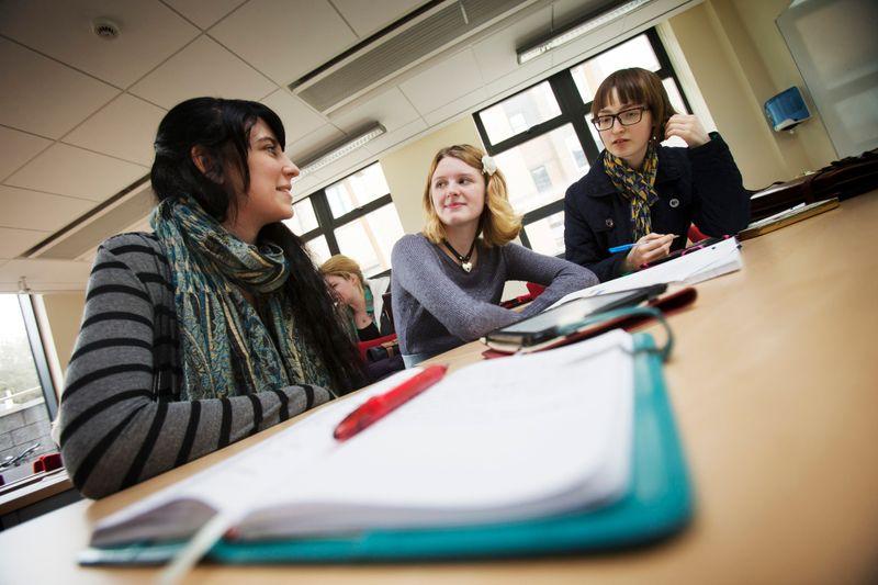 Students chatting during a seminar