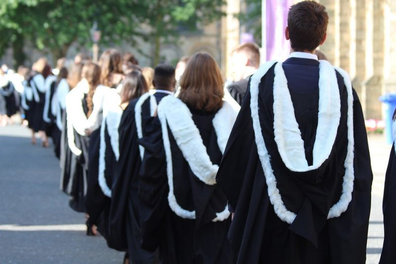 Student procession in graduation gowns
