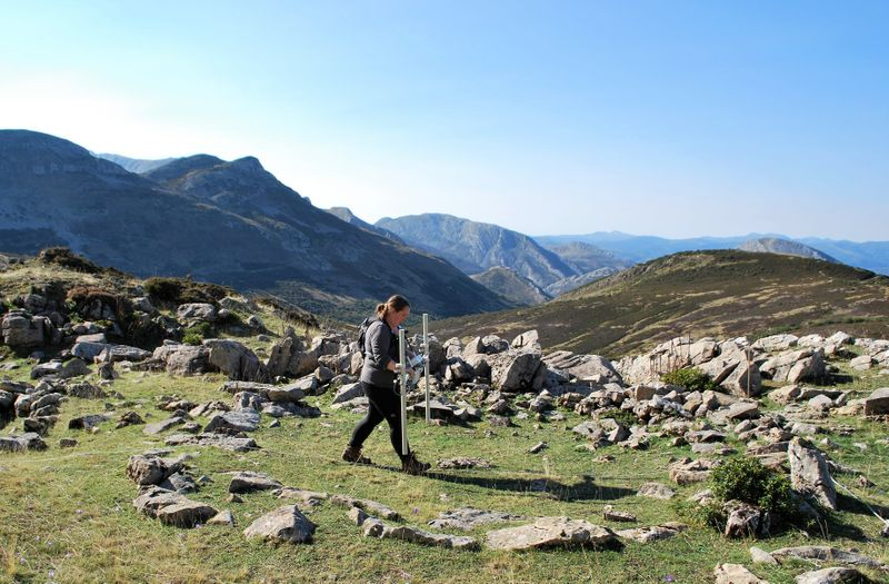 Person walking with two sticks and the Cantabrian Mountains in the background