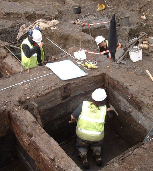 Students inside an excavation during an archaeology field trip