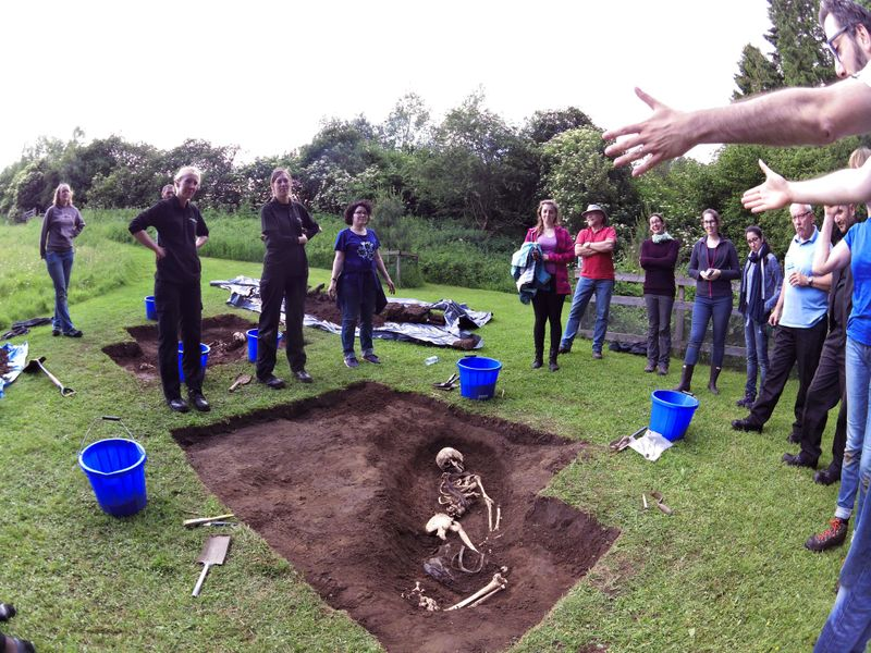 Students standing around an excavated skeleton