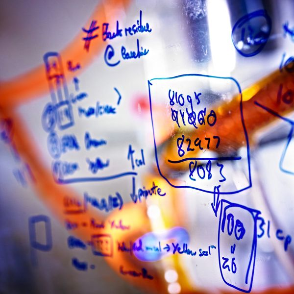 Chemistry equations written on a clear screen