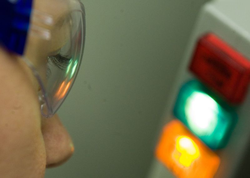 A student with googles looking at some lights
